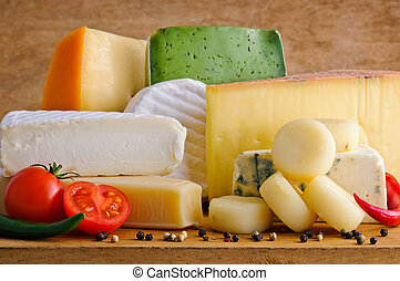 Gourmet cheese - Background with gourmet cheese on a wooden ...