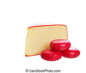 Gourmet Cheeses - Red waxed goumet cheeses on a white ...