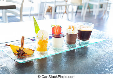 Gourmet coffee served on a plate with glassware in a ...