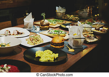 Gourmet food on a wooden table.