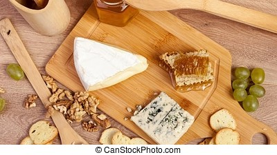 Gourmet food on wooden background. Rich lifestyle