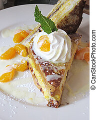 gourmet french toast with orange sauce and mint