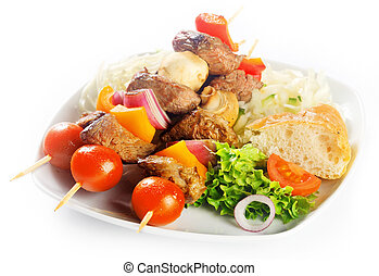 Close up Gourmet Kebabs on White Plate with Bread and Fresh Vegetables. Isolated on White Background.