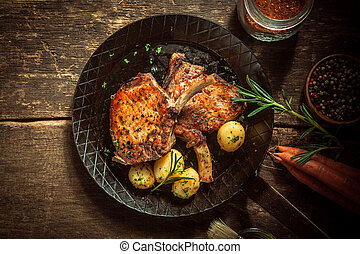 Gourmet meal of marinated pork cutlets served with boiled ...