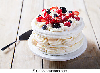 Gourmet pavlova cake with fresh berry topping