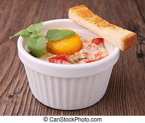 baked egg - gourmet ramekin with baked egg