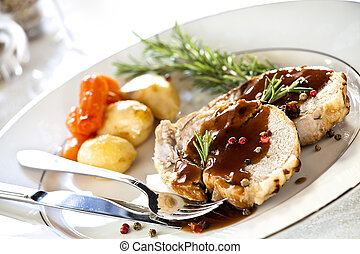 Gourmet Roasted Pork - Close up photograph of slices of...