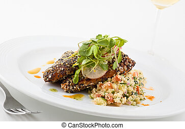 Gourmet salmon dish. - Gourmet salmon dish garnished with...