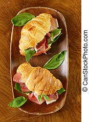 gourmet sandwich croissant with ham