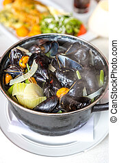 gourmet Steamed mussels with fresh herbs for a tasty seafood...