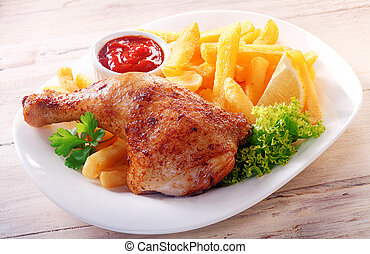 Gourmet Tasty Chicken and Fries on a White Plate