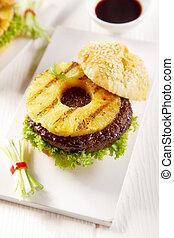 Gourmet Tasty Hawaiian Burger on a White Plate