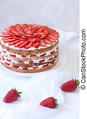 Gourmet traditional strawberry sponge cake weet dessert food served with sweet strawberries on white kitchen table