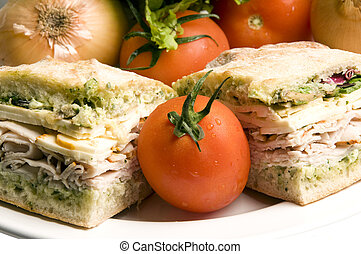 gourmet ovengold roast turkey sandwich with muenster cheese sliced avocado spring mix pesto mayonaisse on ciabatta bread