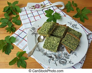 Goutweed ginger cake on plate, organic food with wild plants