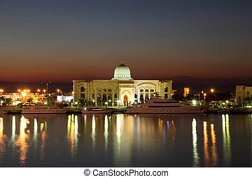 Government building at night in Sharjah, United Arab ...