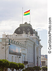 Government building facade view, Sucre, Bolivia. Bolivian flag