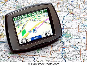 GPS or Map - Portable GPS for a car sitting on a map