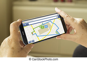 gps smartphone - tourism and travel concept: mature woman...