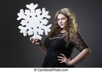 grå, kvinna, dres, svart fond, plus, snöflinga, storlek