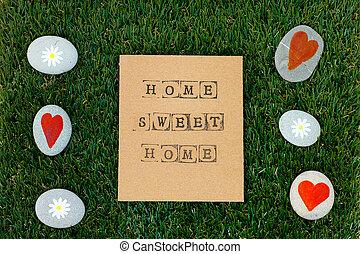 grün, gänseblümchen, hearts., einige, hintergrund, daheim, pappe, kieselsteine, lieb, wörter, gras