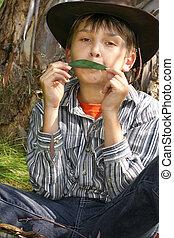 grün, musik, -, a, junge, spielende , gumleaf, melodie