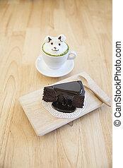 grüner tee, garnierung, gemacht, per, milchschaum, oberseite, auf, der, becher, von, heiß, grüner tee, und, schokoladenkuchen