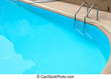 Grab bars ladder in the blue swimming pool