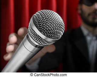 Grab the mic - A youg man on stage about to grab a...