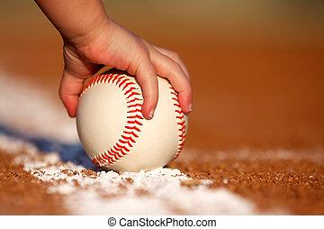 Grabbing a Baseball - Child's hand grabbing a baseball