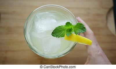 Grabbing a Lemonade - Removing a glass of lemonade garnished...