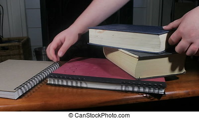 grabbing a stack of books - Hands choosing books from a pile...