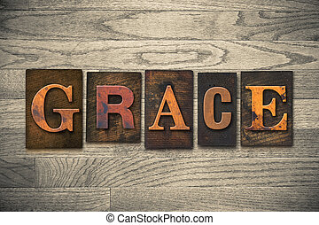 "The word ""GRACE"" written in wooden letterpress type."