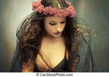 graceful young woman with wreath of flowers and black veil