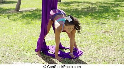 Graceful acrobatic dancer working out