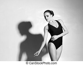Graceful ballerina dancing in a studio