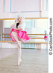 Graceful ballerina dancing in Russian costume