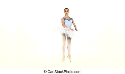 graceful ballerina in ballet pose on white, slow motion