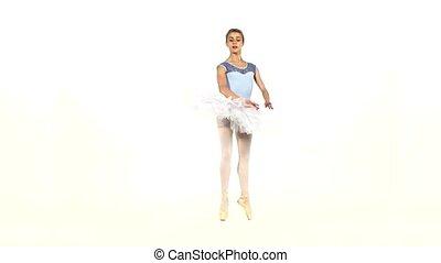 graceful ballerina in ballet pose on white, slow motion