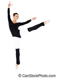Graceful ballerina training in a black leotard and leggings...