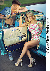 Graceful blond woman sitting in the car