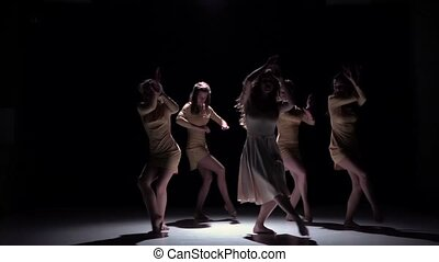 Graceful contemporary dance of five talanted dancers in white suits, sensual, on black background, shadow, slow motion