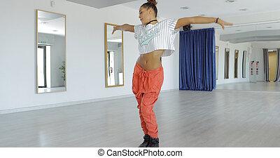 Graceful dancer in studio