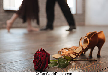 Graceful dancers tangoing in the dance studio