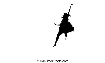 Graceful girl dancer dancing contemporary dance, jumps on white, silhouette, slow motion