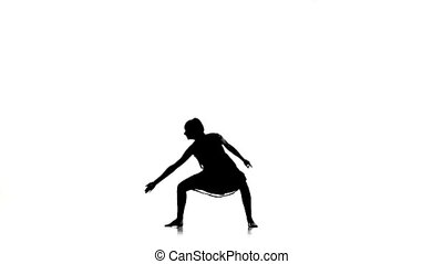 Graceful girl dancer dancing contemporary dance on white, silhouette, slow motion