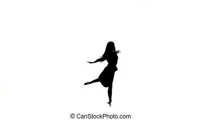 Graceful girl with long hair dance modern contemporary style and jumps on white, silhouette, slow motion