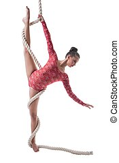 Graceful gymnast doing vertical splits with rope