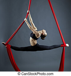 Graceful gymnast performing aerial exercise - Image of...