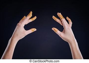 Graceful hands gesturing on black background
